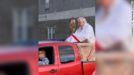 A priest rode around in the back of a pickup truck blessing people in Philadelphia