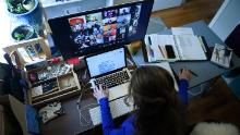 A substitute teacher works from her home in Arlington, Virginia, using Zoom to communicate with students and their families. (Olivier Douliery/AFP/Getty Images)