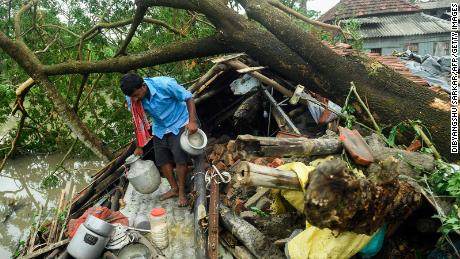 A man salvages items from his house damaged by Cyclone Amphan in Midnapore, West Bengal, on May 21, 2020.