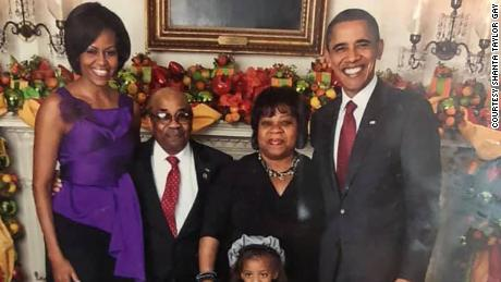 Former White House butler Wilson Roosevelt Jerman with then president Barack Obama and first lady Michelle Obama.