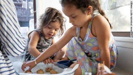 Making cookies together can be as fun as eating cookies together.