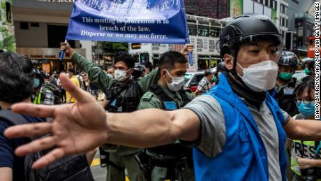 Police tell pro-democracy protesters gathered in Hong Kong's Causeway Bay district to leave on May 24, 2020, ahead of planned protests against a proposal to pass new security legislation in Hong Kong.