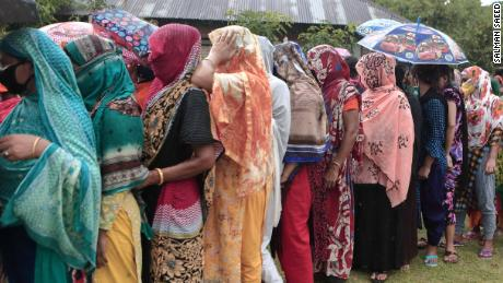Women queue up to receive an aid delivery at the Daulatdia brothel in Bangladesh on May 14.