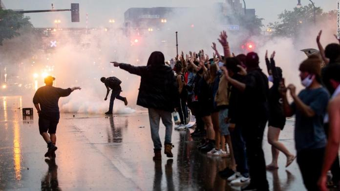 Tear gas is fired as protesters clash with police in Minneapolis on May 26.
