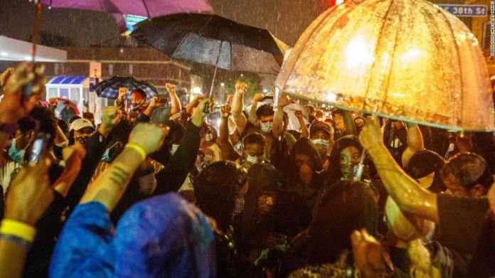 Minneapolis protesters gather in the rain on May 26.