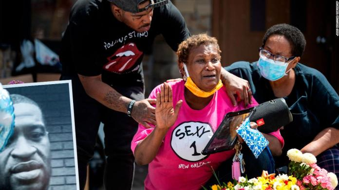 Gwen Dumas is consoled near a convenience store in Minneapolis on May 28.