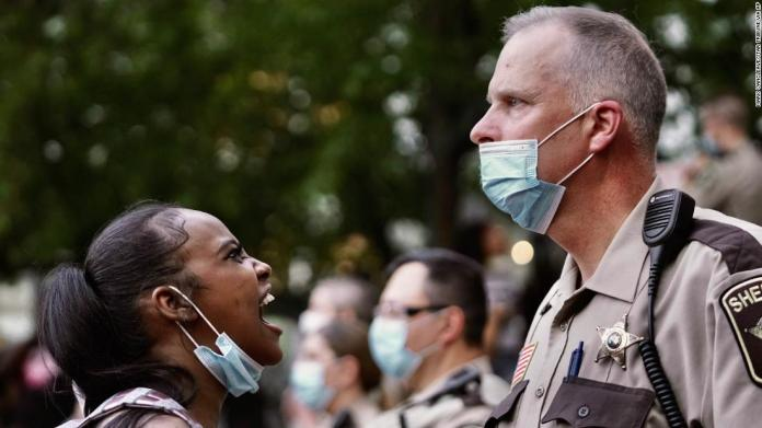 A woman yells at a sheriff's deputy during a protest in Minneapolis on May 28.