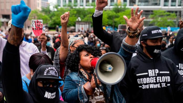 Jamela J. Pettiford sings during a protest outside the Hennepin County Government Center in Minneapolis on May 29.