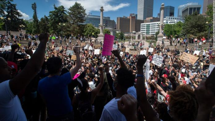 Protesters chant in Civic Center Park during a rally in Denver on May 29.