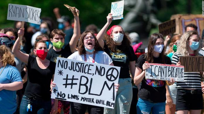 Protesters gather in Kansas City, Missouri, on May 29.