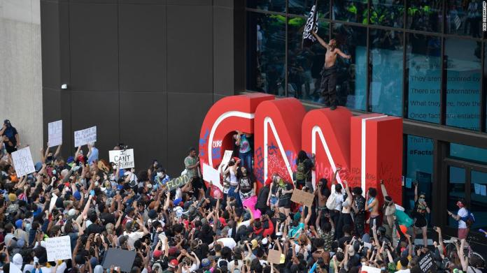 Demonstrators protest outside CNN headquarters in Atlanta on May 29.