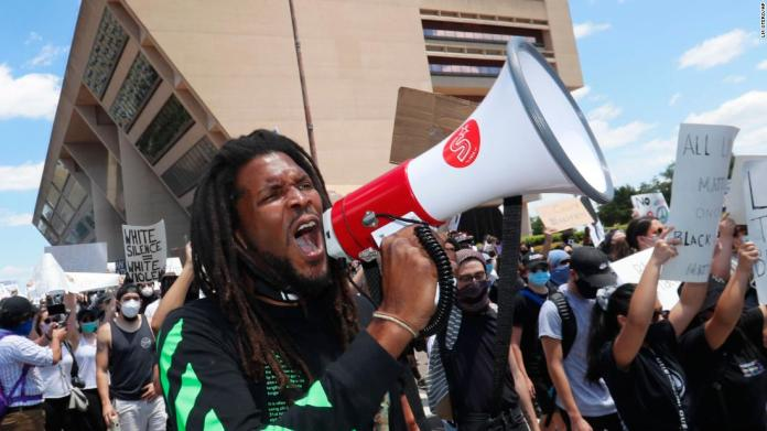 Protesters chant outside Dallas City Hall on May 30.