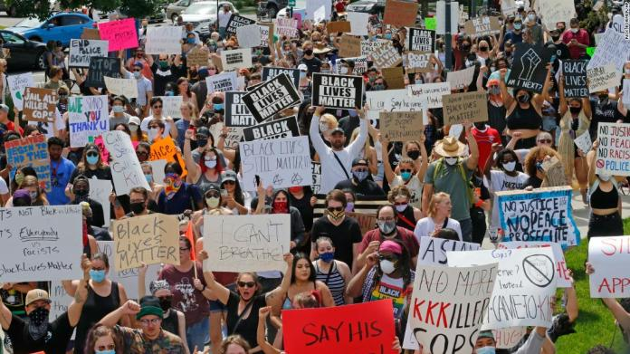 Protesters march near the Salt Lake City Police Department on May 30.