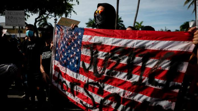 Protesters march during a rally in Fort Lauderdale, Florida, on May 31.