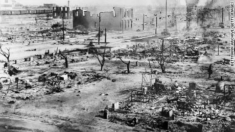 The photo shows the effects of a white mass attacking black residents and businesses from the Greenwood District in Tulsa, Oklahoma.