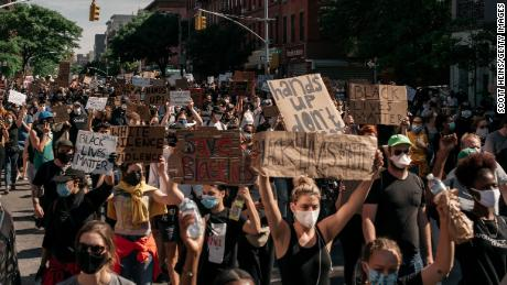 Protesters against police brutality march through Brooklyn on June 3 in New York City.