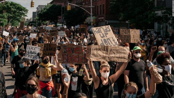 Demonstrators march through Brooklyn, New York, on June 3.