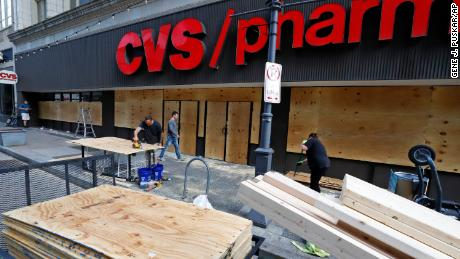 Windows broken in a downtown Pittsburgh CVS Pharmacy are repaired.