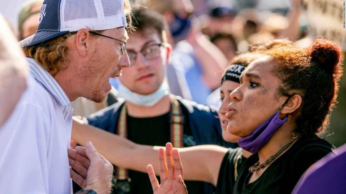 Jessica Moore attempts to hold dialogue with a counter-protester while rallying in Anna, Illinois, on June 4.