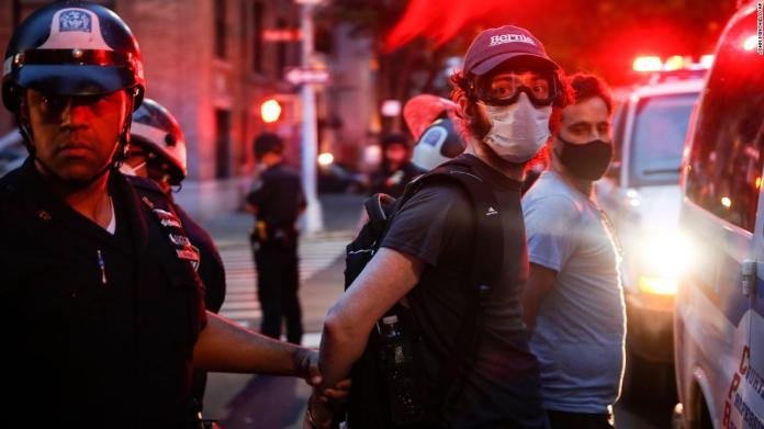 Protesters are arrested after violating curfew in New York on June 5.