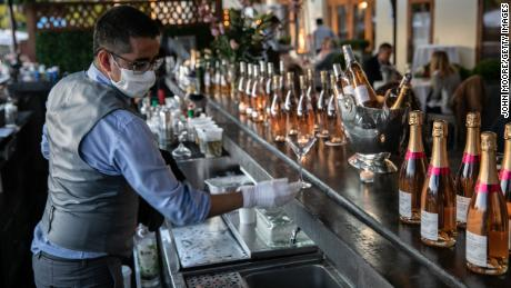 A bartender serves drinks at L'escale restaurant  in Greenwich, Connecticut.