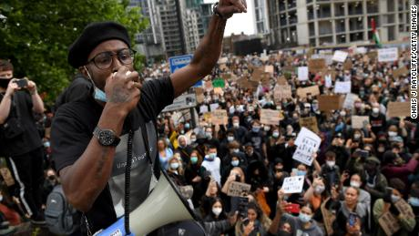 An activist addresses the crowd near the US Embassy in London.
