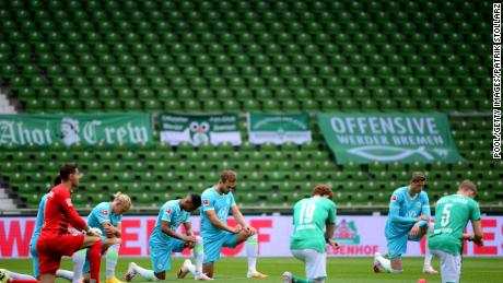 Players from both teams take a knee in protest prior to the Bundesliga match between SV Werder Bremen and VfL Wolfsburg in Germany on Sunday.