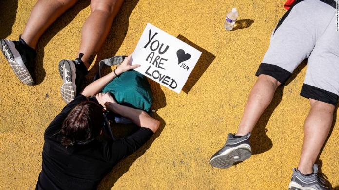 Protesters lie in a street near the White House on June 7.