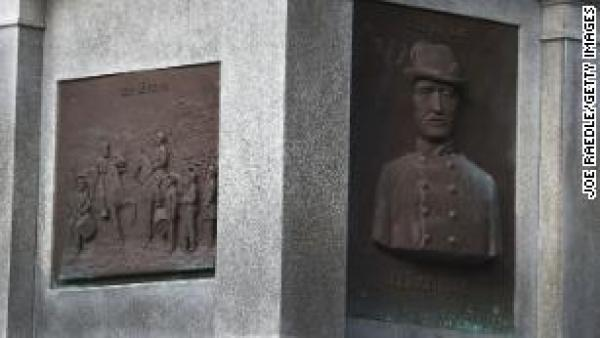 Plaques in honor of Confederates on the base of a monument in Hemming Park.