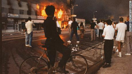 Businesses beginning to burn on Pico Boulevard during the Rodney King riots on April 30, 1992 in Los Angeles.