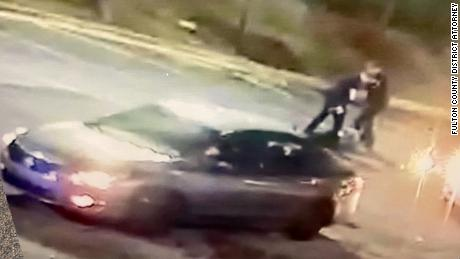Officer Devin Brosnan is seen in this still image standing on Rayshard Brooks after he was shot, Fulton County District Attorney Paul Howard said.