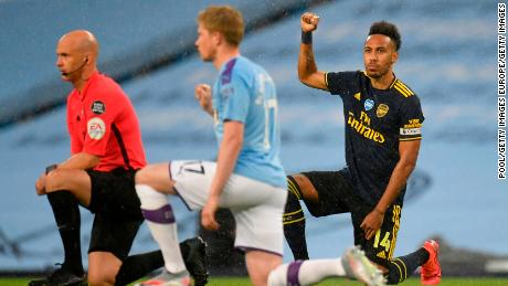 Pierre-Emerick Aubameyang takes a knee in support of the Black Lives Matter movement prior to the Premier League match between Manchester City and Arsenal at the Etihad Stadium.