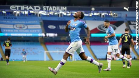 Raheem Sterling celebrates after scoring his team's first goal against Arsenal.