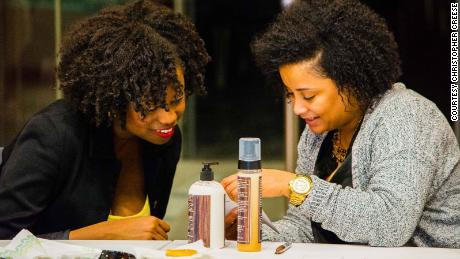 Williams (left) speaking with one of her Black upStart students.