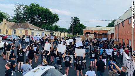 Protesters stand outside the building where the school board met on Monday, June 22.