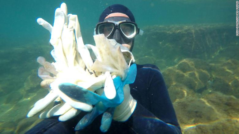 PPE gloves floating in the sea