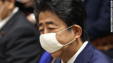 Japanese Prime Minister Shinzo Abe wearing a face mask amid concerns over the spread of the coronavirus speaks during a budget committee session at the lower house of parliament in Tokyo on June 10, 2020.