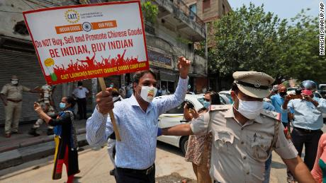 Tensions between China and India are spreading to global business.