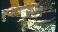 Astronauts work on the distant starboard beam (S6 beam) from the space station.
