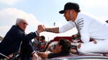 Bernie Ecclestone and Lewis Hamilton shake hands before the Mexico Grand Prix in 2015.
