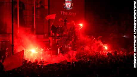 Fans also gathered outside Anfield stadium on Thursday.