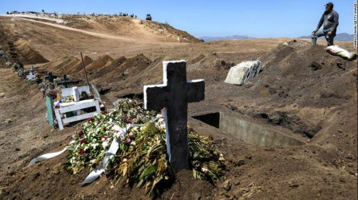 A cemetery worker takes a break from digging new graves at Tijuana Municipal Cemetery 13 amid the COVID-19 pandemic on May 11, 2020 in Tijuana, Mexico.