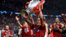 MADRID, SPAIN - JUNE 01: Trent Alexander-Arnold of Liverpool celebrates with the Champions League Trophy after winning the UEFA Champions League Final between Tottenham Hotspur and Liverpool at Estadio Wanda Metropolitano on June 01, 2019 in Madrid, Spain. (Photo by Matthias Hangst/Getty Images)