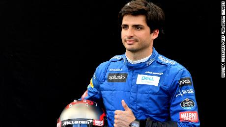 Sainz poses for a photo ahead of the Formula 1 Australian Grand Prix in Melbourne on March 12, 2020. The race was eventually postponed because of the coronavirus pandemic.