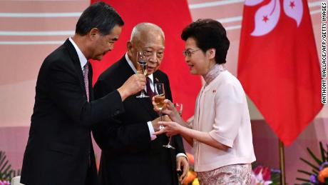 Hong Kong's Chief Executive Carrie Lam (right) makes a toast with former leaders Tung Chee-hwa (center) and Leung Chun-ying (left) following a ceremony to mark the 23rd anniversary of Hong Kong's handover on July 1, 2020.