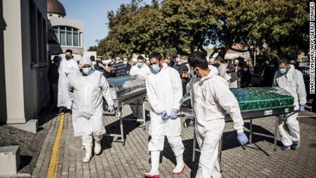 Undertakers carry coffins after funerals for Covid-19 victims at a Cape Town mosque in June. The Western Cape province is now in the middle of the peak of its coronavirus surge.