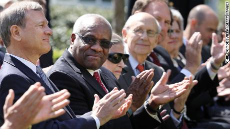 In this April 10, 2017, file photo, Supreme Court Chief Justice John Roberts and associate Justices Clarence Thomas, Ruth Bader Ginsburg, Stephen Breyer and Samuel Alito attend the ceremony where Judge Neil Gorsuch takes the judicial oath during a ceremony in the Rose Garden at the White House.