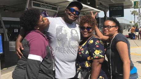 """Atatiana, Adarius and Amber Carr pose with """"sister-cousin"""" Cerese Fortson In San Diego in 2018."""