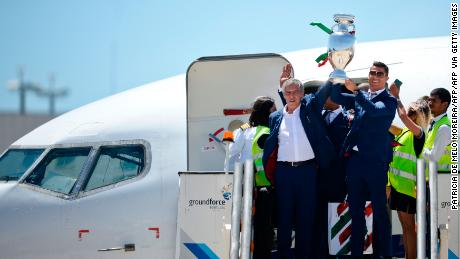 Fernando Santos (left) and Cristiano Ronaldo return to Lisbon with the European championship trophy.