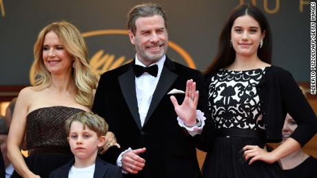 """US actor John Travolta (2ndR), his wife US actress Kelly Preston (L) and their children Ella Bleu Travolta (R) and Benjamin Travolta pose as they arrive on May 15, 2018 for the screening of the film """"Solo : A Star Wars Story"""" at the 71st edition of the Cannes Film Festival in Cannes, southern France. (Photo by Alberto PIZZOLI / AFP)        (Photo credit should read ALBERTO PIZZOLI/AFP via Getty Images)"""
